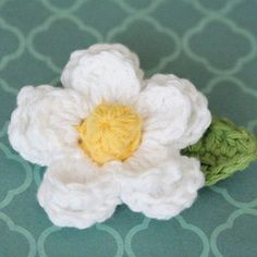 I'm currently going back through and taking better photos of some of my original patterns. It's kind of slow going since I actually have to go through and remake each item, but I'm enjoying the process. The original photo and pattern for this adorable daisy can be found here. I've added a bobble center and...