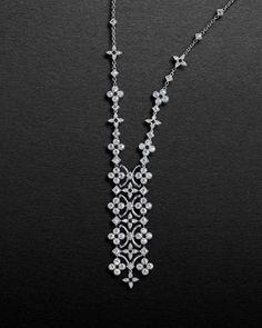 Louis Vuitton Dentelle de Monogram collection. White gold and diamonds.