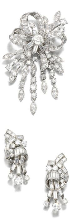 *DIAMOND BROOCH, MONTURE CARTIER, 1950S AND PAIR OF EAR CLIPS. The brooch of articulated foliate and ribbon design, set with circular-, single-cut and baguette diamonds, signed MTD Cartier; the ear clips set with brilliant-cut and baguette diamonds.
