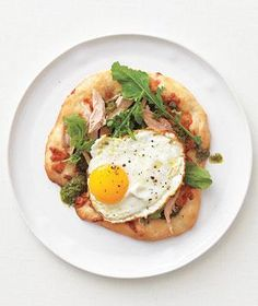 Chicken, Pesto, and Fried Egg Pizza Pierce the yolk and let it coat the arugula and chicken before slicing.