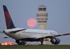 Delta N631DL, a B757-232 retired in April 2012. Beautiful photo taken at ATL with a pink moon by the ATC tower.