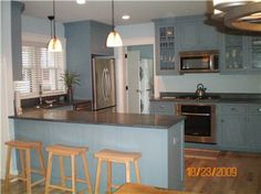 Blue cabinets give this Martha's Vineyard kitchen a beachy feel