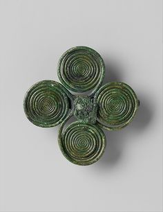 Brooch Date: 8th century B.C. Culture: German Medium: Copper alloy Dimensions: Overall: 2 11/16 x 2 3/4 x 9/16 in. (6.8 x 7 x 1.5 cm) Classification: Metalwork-Copper alloy