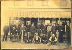 In this rare historic photo, Luke Short, Wyatt Earp, Doc Holliday, Bat Masterson, Bill Tilghman and Jim Masterson, along with Pat and Mike Sughrue, are among the people shown in front of the Wichita County bank at Coronado, shortly after the famous county-seat gunfight. (Photo courtesy of the Wichita County Museum)
