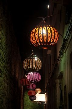 Where could I put lanterns like this? Maybe make it with white plastic globe light fixture, black rickrack or lace on outside, maybe even patterned nylons pulled over it, and a colored bulb inside
