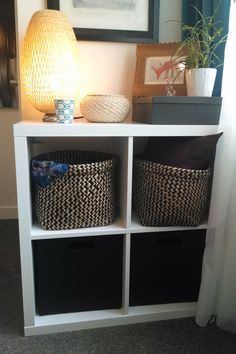 The KALLAX shelving unit; plus some great textured baskets, adds storage and pattern to this small space.