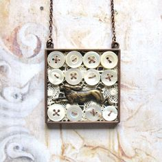 Vintage Buttons, Lace, and Running Hare Necklace / ComeDayGoDay, etsy