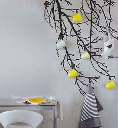 Love this idea! Paint a tree... add some hooks... and voila...decorative storage!