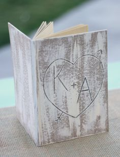 Personalized Engraved Heart And Arrow Faux Wood Guest Book Journal (item E10107). $29.99, via Etsy.