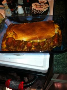CHILI CHEESE DOG CASSEROLE- my version...spread 1/2 tube crecent rolls over bottom of pan, add mustard, ketchup, hot dogs, hot sauce, chili, onions and shreaded cheddar and top with other half of tube of cresent rolls!