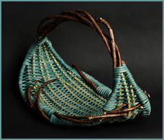 """Tina Puckett  Simplicity (2009)    H 10"""" W 10"""" D 10""""    Twisted bittersweet forms the frame of this basket, which is woven with aquamarine-colored reeds and yellow spokes."""