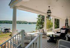 The big back porch is just steps from the water: House on Lake Michigan | hookedonhouses.net
