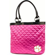 """NCAA Clemson University Pink Quilted Tote by Little Earth. $25.75. Littlearth's Quilted Collection is the perfect bag for the astute Sports Fan.  This Quilted Tote measures 16"""" Length x 5.5"""" Width x 12"""" Height and has an 8"""" Handle Drop.  Trimmed in faux leather this bag features rich satin-like quilting sure to catch the eye of passersby.  Displays embroidered applique of favorite team logo in bottom front right of bag.  Magnetic snap closure at top of bag keeps belongings secu..."""