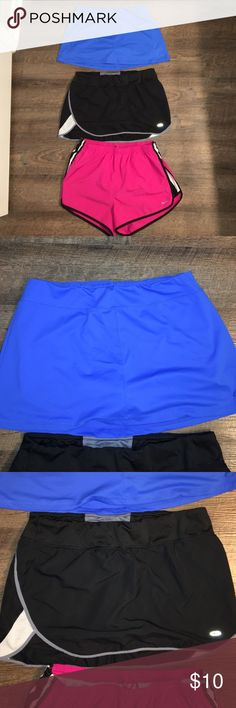 """Nike & Champion Workout Skorts & Shorts Selling as a lot.  Two workout skirts with built in shorts, both are Champion brand. Blue is a medium and black is a large.  Pink Nike shorts have built in """"underwear"""" and they are size large.  Pet free, smoke free home.  All in great used condition. Nike Shorts Skorts"""
