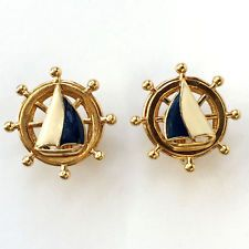 Gold plated ear clips in shape of wheel with enameled Yacht on top, s... Lot 330