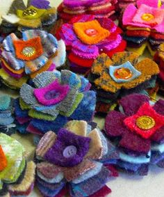 #eco-chic #upcycled felted wool scraps are reborn into a SEVEN-layer posie! Still decorated with a vintage button center and sewn by hand. 2-3/4 inch diameter. Sold in packs of 2. More
