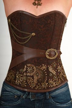 Steampunk brown jacquard print corset with brass metal accents, brown veggie-leather belt and trim, and side brass zipper for easy on and off.. Get the supplies to make it: http://mjtrends.com/pins.php?name=brown-faux-leather-for-corset