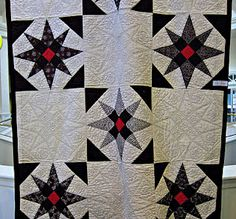 Lap quilt, hand quilted with black thread