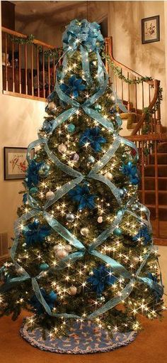Blue Christmas trees remind me of my grampa. He LOVED blue Christmas trees. Christmas Time Is Here, Noel Christmas, All Things Christmas, Winter Christmas, Christmas Crafts, Christmas Tree Ribbon, Christmas Photos, Christmas Hair, Google Christmas