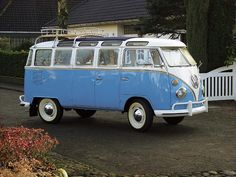 VW bus with chrome luggage rack AND sunroof AND white wall tires ANNND it's blue.  This is a dream car....