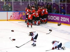 Marie-Philip Poulin #29 of Canada celebrates with teammates after scoring the game-winning goal against the United States in overtime | Sochi 2014 Winter Olympics