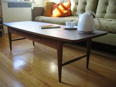 Scavenger:  Mid-century Danish modern style coffee table w/drawer for $200