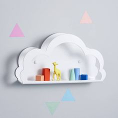 A bright white cloud shelf designed in house.A beautiful home accessory; a white fluffy cloud shelf for your nursery, a child's bedroom, your office, almost anywhere. Designed by us here at Pink Biscuits and made exclusively for us to sell here at Not On The High Street. This shelf comes with a wall hanging kit or can simply be placed on a piece of furniture to have the same effect. Perfect for a display, accessories or a collection. The cloud has a solid back piece and a hollow front cloud…