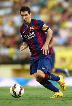 Lionel Messi of Barcelona runs with the ball during the La Liga match between Villarreal CF and FC Barcelona at El Madrigal stadium on August 31, 2014 in Villarreal, Spain.