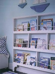 We love the nautical feel of this bookcase - the rope is a nice touch. #nauticalboysroom   #nauticalbedroom