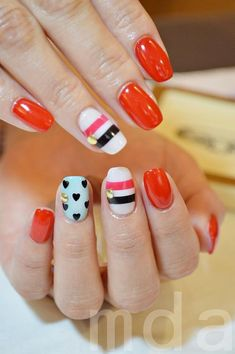cute nail design.  I would switch out the red for a deeper toned red or a different color all together.