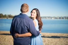 Engagement photography at the Coronado boat ramp in San Diego.
