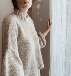 Felice is a cozy oversized sweater with a dropped shoulder, ribbed finishing and longer back for a relaxed silhouette. It is worked top down in stockinette stitch by working back and front separately first, then joining to work in the round and finally picking up the stitches for the the sleeves from the body. The folded neck is worked by picking up the stitches from the neckline.