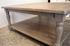 Antique cypress herringbone coffee table with gray wash. Antique balusters.