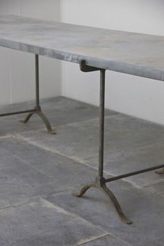 A C19th weathered zinc top trestle table