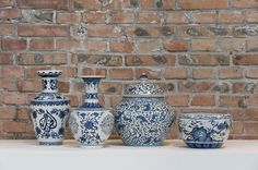 """Blue and White (2012) - Egyptian Artist MOATAZ NASR """" 32 Ceramic vases that retell the contemporary history of Egypt are sculptured and painted in a manner similar to that of porcelain art from China...."""