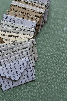 tiny envelopes made from book pages - sweeeeet.