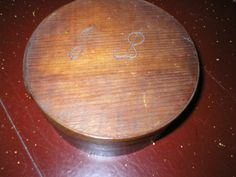 """Archive Photo: Round Wood Spice Box, initialed on top """"L (or J) B"""". Object ID: 1926.212.001      As seen in on the table in the Old Kitchen of the Historic Atwood House, Chatham, MA. #atwoodhouse, #spice, #box, #atwood, #chathamhistoricalsociety, #chatham, #capecod"""