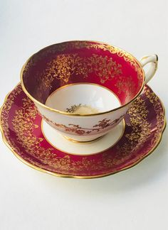 Gorgeous Vintage Red and Gold Hammersley Teacup and Saucer. Pattern 4419/1 English Fine Bone China. Hard to find pattern This is a stunning teacup set in a rich red and heavily overlaid with gold filigree in a floral pattern. The center of the teacup and saucer have an elaborate gold