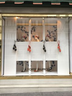Tory Burch Spring Windows, New Bond Street Plastered walls, paper flowers and bespoke louvre doors to crreate changing rooms for Tory Burch.