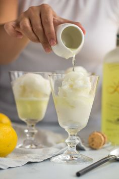 limoncello prosecco floats with lemon sorbetto are the perfect boozy dessert cocktail for summer! a scoop of lemon sorbetto gets simply drowned with a shot of limoncello Limoncello Cocktails, Drinks With Lemoncello, Lemoncello Dessert, Homemade Limoncello, Cocktail Desserts, Cocktail Recipes, Fun Drinks, Yummy Drinks, Alcoholic Beverages