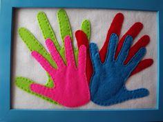 As mãos da nossa família em feltro (peixinhos no sotão).