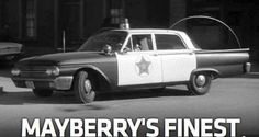 Love the old black and white police cars.