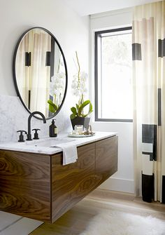 Modern wooden floating vanity with circular mirror design | M House, Inc