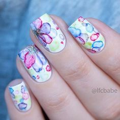 Aquarell Nail Art Ideen Create watercolor flowers on your nails with this watercolor nail art for reference. To add to the effect, you can also put on silver dust on top to further accentuate the flowers. Use a light combination of colors for a more p Marble Nail Designs, Marble Nail Art, Cool Nail Designs, Water Color Nails, Water Nails, Love Nails, Pretty Nails, Bright Nails, Manicure E Pedicure