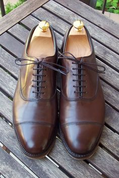 Allen Edmonds Cap-Toed Oxfords. Nice brown shoe that would go well with any shade of blue or grey suit or almost any for that matter.