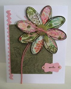 love the use of patterned paper under the stamp work on the petals; handmade card