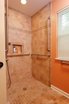 Wheelchair Accessible Bathroom by Bauscher Construction  Like the layout of tile/ accents. Curb less entry.