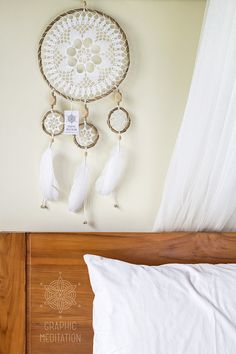 This large white dream catcher will make a great decorative touch to any space. Perfect for wedding ceremony decorations. It also would be a special and unique gift for a birthday or in any other occasion.  The dream catcher is intended to protect the sleeping individual from negative dreams, while letting positive dreams through.  •  The doily is individually knitted from cotton thread •  Hoops are hand made from bamboo rods also by myself •  Natural goose feathers and wooden beads are used…