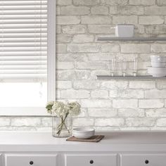 Fashion your own brick wall in a matter of minutes with this chic peel and stick wallpaper. Treated to a beautiful rustic finish, this grey and white faux brick design brings a dimensional look to walls that are both authentic and grand. White Wash Brick, White Brick Walls, Faux Brick Walls, White Brick Backsplash, Kitchen Backsplash, Backsplash Ideas, Peal And Stick Backsplash, Kitchen Cabinets, White Cabinets