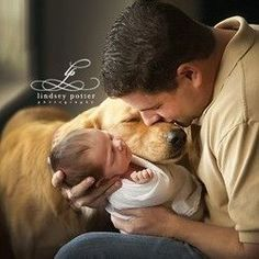 baby and daddy pictures // newborn portraits with dogs and pets // baby and animal pictures that are just too cute